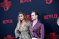 "LOS ANGELES - JUN 28:  Liv Pollock, Dacre Montgomery at the ""Stranger Things"" Season 3 World Premiere at the Santa Monica High School on June 28, 2019 in Santa Monica, CA"