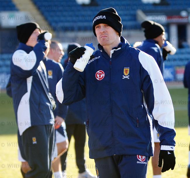 Darren Fletcher has a drink at Scotland training