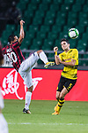 Borussia Dortmund Defender Marc Bartra (R) trips up with AC Milan Midfielder Hakan Calhanoglu (L) during the International Champions Cup 2017 match between AC Milan vs Borussia Dortmund at University Town Sports Centre Stadium on July 18, 2017 in Guangzhou, China. Photo by Marcio Rodrigo Machado / Power Sport Images