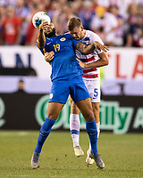 PHILADELPHIA, PA - JUNE 30: Jafar Arias #19 and Walker Zimmerman #5 go for a header during a game between Curaçao and USMNT at Lincoln Financial Field on June 30, 2019 in Philadelphia, Pennsylvania.