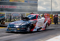 Jul 12, 2020; Clermont, Indiana, USA; NHRA funny car driver Tommy Johnson Jr during the E3 Spark Plugs Nationals at Lucas Oil Raceway. This is the first race back for NHRA since the start of the COVID-19 global pandemic. Mandatory Credit: Mark J. Rebilas-USA TODAY Sports
