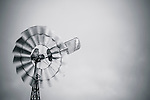 Spinning windmill in pastures west of Quirindi in the New England region of New South Wales in Australia. This area primarily produces sunflowers and sorghum.