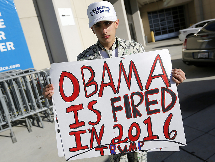 16-year-old Ashton Kahn holds a sign in support of Republican U.S. presidential candidate Donald Trump before a rally in Baton Rouge, Louisiana February 11, 2016. REUTERS/Jonathan Bachman