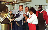 United States Vice President Al Gore helps prepare soup at Martha's Table, a shelter that provides meals to the homeless in Washington, D.C. on 15 October, 1999.  Pictured from left to right: VP Al Gore; US Representative Tony Hall (Democrat of Ohio), former Chairman of the US House Select Committee on Hunger; Olivia Ivy, Director of Operations at Martha's Table; and Alvin Winfield, a volunteer at the shelter; look on.<br /> Credit: Ron Sachs / CNP