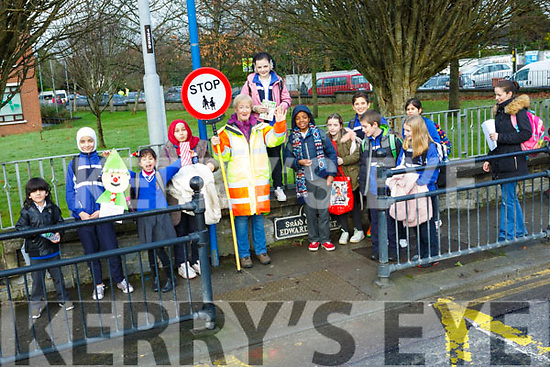Catherine Dolan with the children ready to safely cross the road, on her last day as the Crossing Guard at CBS Primary school.