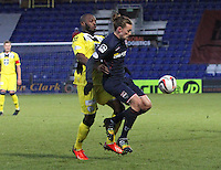 Jackson Irvine shielding the ball from Isaac Osbourne in the Ross County v St Mirren Scottish Professional Football League match played at the Global Energy Stadium, Dingwall on 17.1.15.