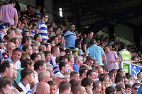 FAO SPORTS PICTURE DESK<br /> Pictured: Disappointed QPR supporters leave the stands early. Saturday 18 August 2012<br /> Re: Barclay's Premier League, Queens Park Rangers v Swansea City FC at Loftus Road Stadium, London, UK.