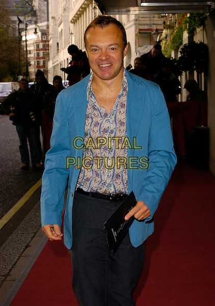 GRAHAM NORTON.The South Bank Show Awards, Savoy Hotel, London, UK..January 23rd, 2007.half length grey gray trousers blue suit jacket floral print shirt.CAP/CAN.©Can Nguyen/Capital Pictures