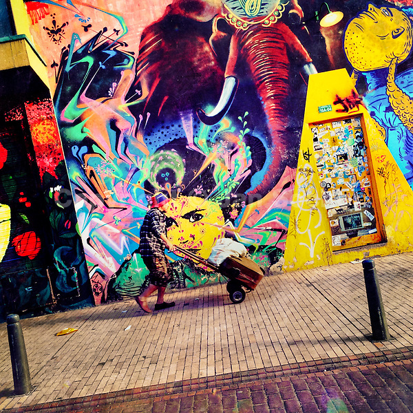 A Colombian street vendor passes in front of a graffiti artwork, created by an artist named Stinkfish, in La Candelaria, Bogotá, Colombia, 14 February, 2016. A social environment full of violence and inequality (making the street art an authentic form of expression), with a surprisingly liberal approach to the street art from Bogotá authorities, have given a rise to one of the most exciting and unique urban art scenes in the world. While it's technically not illegal to scrawl on Bogotá's walls, artists may take their time and paint in broad daylight, covering the walls of Bogotá not only in territory tags and primitive scrawls but in large, elaborate artworks with strong artistic style and concept. Bogotá has become an open-air gallery of contemporary street art.