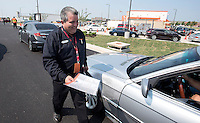 NWA Democrat-Gazette/J.T. WAMPLER Art Acosta, general manager for Whataburger in Rogers, hands out menus Monday Aug. 31, 2015 as a line of cars waits on opening day. The Rogers location is the second the company has opened in Northwest Arkansas with a location in Fayetteville opening in July. Another location is planned for Springdale later this year.