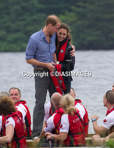 """PRINCE WILLIAM HUGS KATE.after winning the Dragonboat race, Dalvey Lake, Dalvey-by-Sea, Prince Edward Island_04/07/2011.Mandatory Credit Photo: ©DIAS-DIASIMAGES..**ALL FEES PAYABLE TO: """"NEWSPIX INTERNATIONAL""""**..IMMEDIATE CONFIRMATION OF USAGE REQUIRED:.DiasImages, 31a Chinnery Hill, Bishop's Stortford, ENGLAND CM23 3PS.Tel:+441279 324672  ; Fax: +441279656877.Mobile:  07775681153.e-mail: info@newspixinternational.co.uk"""