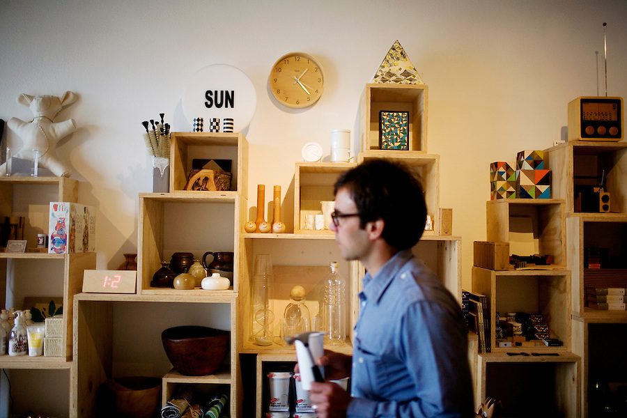 Co-owner Mason St. Peter places products on the shelves at The General Store offers local crafts and vintage items, in San Francisco's far western neighborhood, the Outer Sunset, on Saturday, Oct. 23, 2010.