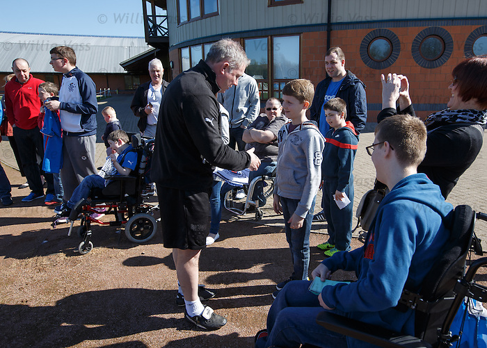 Ally McCoist with young fans at training who were taken up to watch the team by the Sons of Struth supporters group
