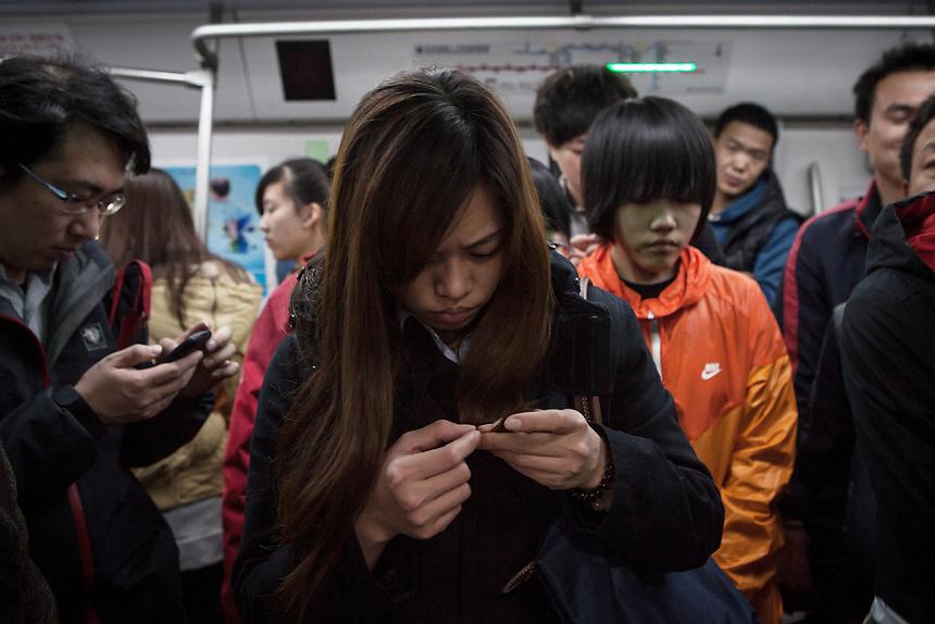 Commuters inside Beijing Metro.