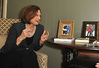 NWA Democrat-Gazette/Michael Woods --04/09/2015--w@NWAMICHAELW...  Adelaide Schaffer with Champions for Kids speaks during an interview in her office Thursday morning on the Fayetteville square.