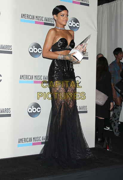 LOS ANGELES, CA - NOVEMBER 24: Rihanna (Robyn Rihanna Fenty) in the press room at the 2013 American Music Awards at Nokia Theatre L.A. Live on November 24, 2013 in Los Angeles, California. <br /> CAP/ADM/RE<br /> &copy;Russ Elliot/AdMedia/Capital Pictures