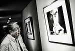 Renowned Japanese photographer and filmmaker Eikoh Hosoe looks at a print of one of his portraits of novelist Yukio Mishima taken in the 1960s in Tokyo, Japan.
