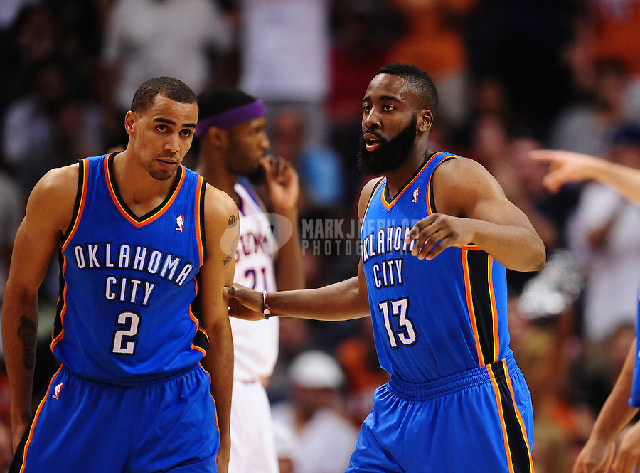 Mar. 30, 2011; Phoenix, AZ, USA; Oklahoma City Thunder guard (2) Thabo Sefolosha and guar (13) James Harden against the Phoenix Suns at the US Airways Center. Mandatory Credit: Mark J. Rebilas-