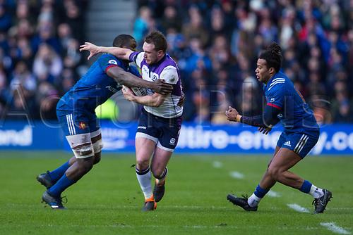 11th February  2018, Murrayfield Stadium, Edinburgh, Scotland; NatWest Six Nations Rugby, Scotland versus France; Stuart Hogg of Scotland hands off to Yacouba Camara of France