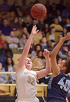 NWA Democrat-Gazette/BEN GOFF @NWABENGOFF<br /> Ashley Murch (32) of Bentonville shoots over Juella Brown of Springdale Har-Ber on Friday Jan. 15, 2016 during the game in Bentonville's Tiger Arena.