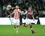West Ham's Dimitri Payet tussles with Stoke's Phil Bardsley during the Premier League match at the London Stadium, London. Picture date November 5th, 2016 Pic David Klein/Sportimage