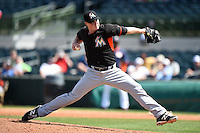 Miami Marlins pitcher Carter Capps (22) during a spring training game against the Houston Astros on March 21, 2014 at Osceola County Stadium in Kissimmee, Florida.  Miami defeated Houston 7-2.  (Mike Janes/Four Seam Images)