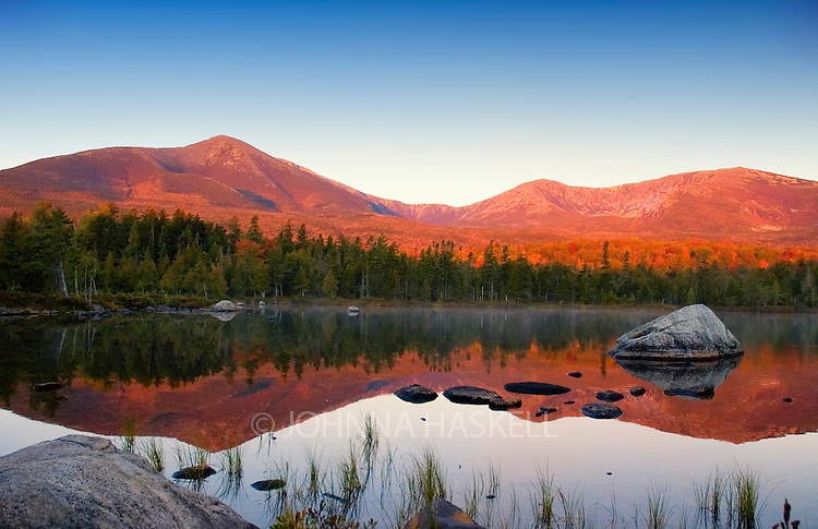 Mt Katahdin early morneing reflections in Sandy Stream Pond in Baxter State Park, Maine. What can't be seen in this photograph is the early activity of a male moose rutting a female during the fall leave changes.