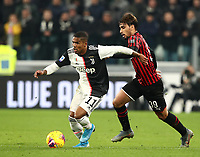 Calcio, Serie A: Juventus - Milan, Turin, Allianz Stadium, November 10, 2019.<br /> Juventus' Doulas Costa (l) in action with Milan's Lucas Paqueta (r) during the Italian Serie A football match between Juventus and Milan at the Allianz stadium in Turin, November 10, 2019.<br /> UPDATE IMAGES PRESS/Isabella Bonotto
