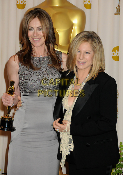 KATHRYN BIGELOW & BARBRA STREISAND.82nd Annual Academy Awards held at the Kodak Theatre, Hollywood, California, USA..March 7th, 2010.oscars half length black suit jacket white lace blouse top silver necklaces grey gray dress sleeveless winner trophy .CAP/ADM/BP.©Byron Purvis/AdMedia/Capital Pictures.