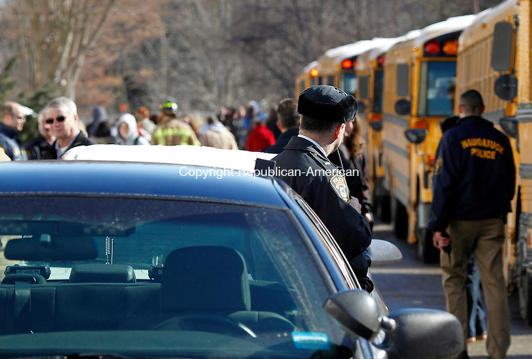 Naugatuck, CT- 03, February 2011-020311CM05  Emergency workers and school officials help dismiss students outside Naugatuck High School Thursday afternoon.  The school was dismissed following the discovery of a large crack on the corner of the building.  Christopher Massa Republican-American