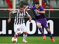 Calcio, ritorno degli ottavi di finale di Europa League: Fiorentina vs Juventus. Firenze, stadio Artemio Franchi, 20 marzo 2014. <br /> Juventus forward Carlos Tevez, of Argentina, is chased by Fiorentina defender Nenad Tomovic, of Serbia, during the Europa League round of 16 second leg football match between Fiorentina and Juventus at Florence's Artemio Franchi stadium, 20 March 2014. Juventus won 1-0 to advance to the round of eight.<br /> UPDATE IMAGES PRESS/Isabella Bonotto