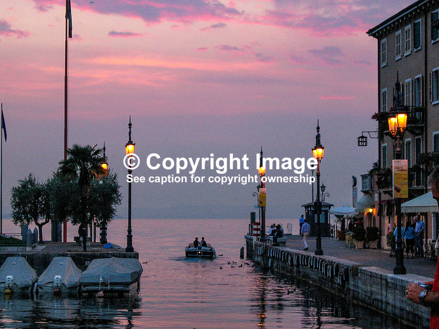 Harbour, Lazise, Italy, dusk, boats, street lights, harbour lights, 200609190291..Copyright Image from Victor Patterson, 54 Dorchester Park, Belfast, UK, BT9 6RJ..Tel: +44 28 9066 1296.Mob: +44 7802 353836.Voicemail +44 20 8816 7153.Skype: victorpattersonbelfast.Email: victorpatterson@mac.com.Email: victorpatterson@ireland.com (back-up)..IMPORTANT: If you wish to use this image or any other of my images please go to www.victorpatterson.com and click on the Terms & Conditions. Then contact me by email or phone with the reference number(s) of the image(s) concerned.