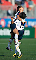 25 May 09:  The Women's USA National Team players celebrate a goal in an International Friendly soccer game between the US Women's Team and the Canadian Women's Team at BMO Field in Toronto. The US Women's Team won 4-0..