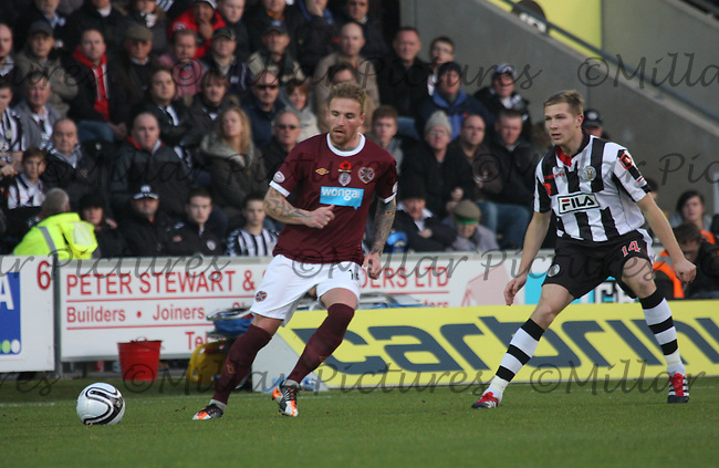 Ryan Stevenson lays the ball back while being marked by Marc McAusland in the St Mirren v Heart of Midlothian Clydesdale Bank Scottish Premier League match played at New St Mirren Park, Paisley on 5.11.11.