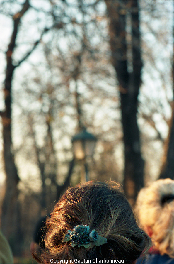 Light falling in the Parque del Buen Retiro, woman's hair catching the light