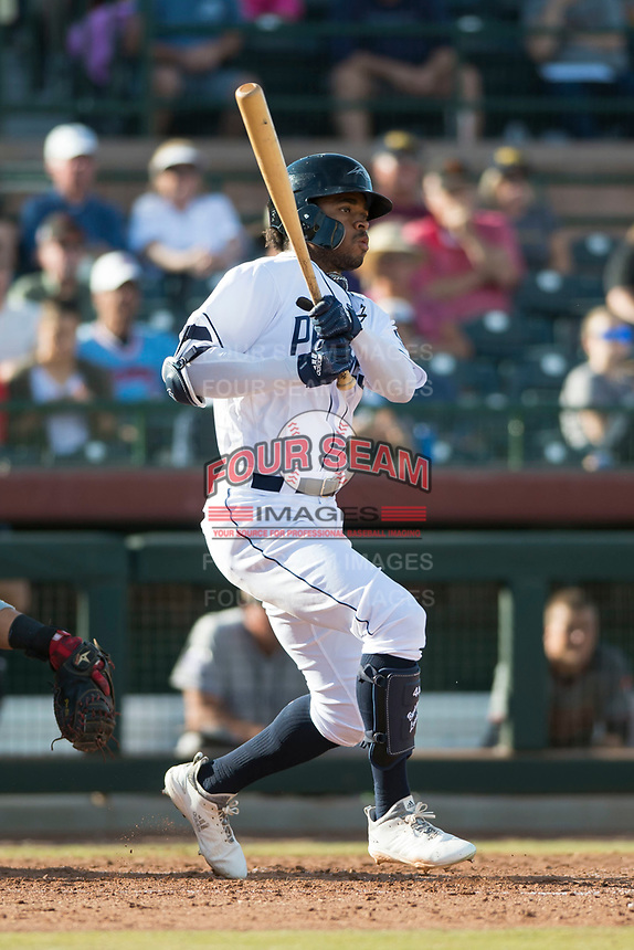 Peoria Javelinas right fielder Buddy Reed (85), of the San Diego Padres organization, follows through on his swing during the Arizona Fall League Championship Game against the Salt River Rafters at Scottsdale Stadium on November 17, 2018 in Scottsdale, Arizona. Peoria defeated Salt River 3-2 in 10 innings. (Zachary Lucy/Four Seam Images)
