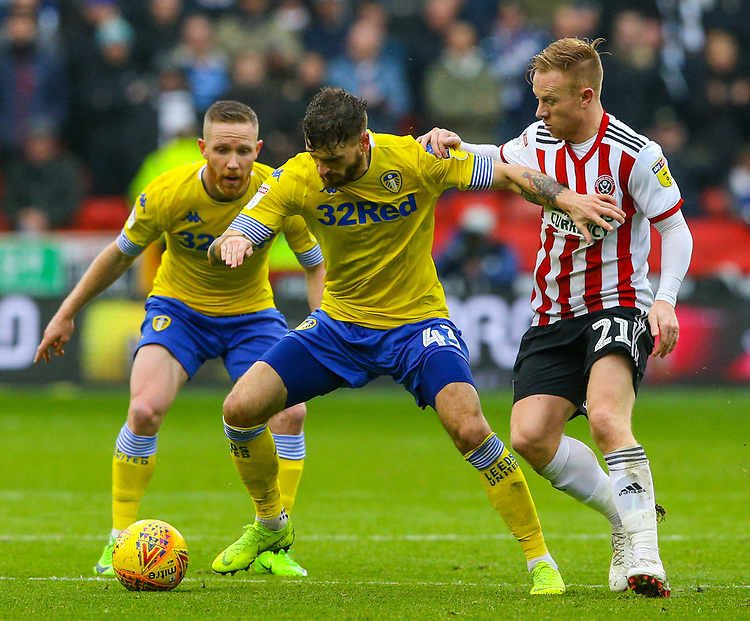 Leeds United's Mateusz Klich holds off the challenge from Sheffield United's Mark Duffy<br /> <br /> Photographer Alex Dodd/CameraSport<br /> <br /> The EFL Sky Bet Championship - Sheffield United v Leeds United - Saturday 1st December 2018 - Bramall Lane - Sheffield<br /> <br /> World Copyright © 2018 CameraSport. All rights reserved. 43 Linden Ave. Countesthorpe. Leicester. England. LE8 5PG - Tel: +44 (0) 116 277 4147 - admin@camerasport.com - www.camerasport.com