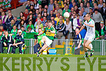 Kieran O'Leary gets the ball past Stephen Lavin in the Muster Senior Semi final held in The Gaelic Grounds last Saturday evening.