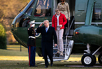 United States President Donald J. Trump salutes a Marine as he steps off of Marine One with first lady Melania Trump, and their son Barron Trump, arrive on the South Lawn of the White House, on March 10, 2019 in Washington, DC. Trump spent the weekend at his Mar-a-Lago club in Palm Bech, Florida.<br /> CAP/MPI/RS<br /> &copy;RS/MPI/Capital Pictures