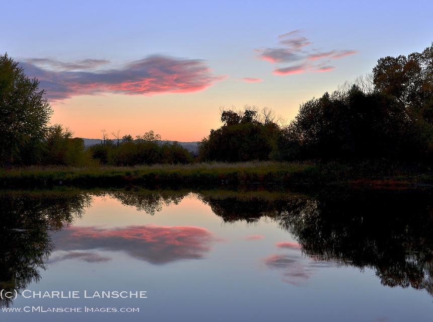 Evening sky reflection over Charlie's Pond. Oakley, Utah.  September 2012.