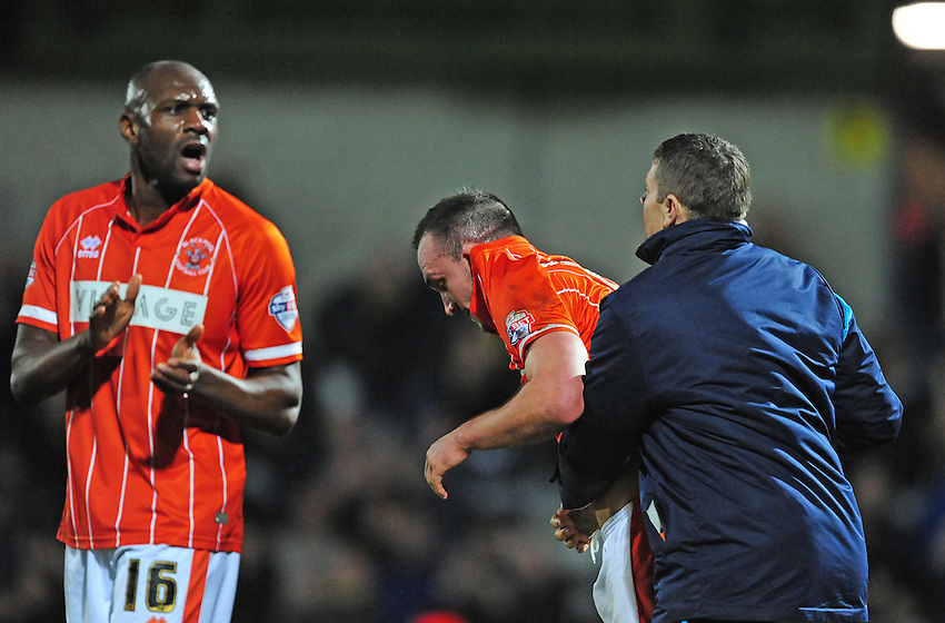 Blackpool's Tom Aldred is guided off the pitch by Blackpool&rsquo;s goalkeeping coach Steve Banks at the end of the game<br /> <br /> Photographer Chris Vaughan/CameraSport<br /> <br /> Football - The Football League Sky Bet League One - Burton Albion v Blackpool - Saturday 2nd January 2016 - Pirelli Stadium - Burton   <br /> <br /> &copy; CameraSport - 43 Linden Ave. Countesthorpe. Leicester. England. LE8 5PG - Tel: +44 (0) 116 277 4147 - admin@camerasport.com - www.camerasport.com