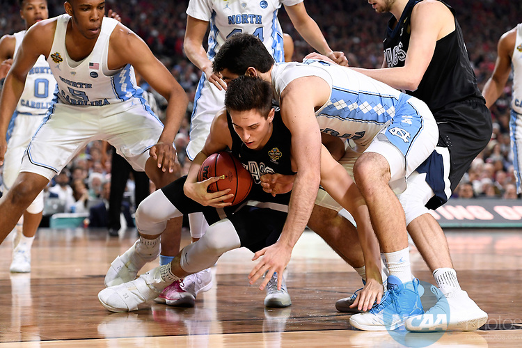 GLENDALE, AZ - APRIL 03: Zach Collins #32 of the Gonzaga Bulldogs takes the ball to the ground the 2017 NCAA Men's Final Four National Championship game against the North Carolina Tar Heels at University of Phoenix Stadium on April 3, 2017 in Glendale, Arizona.  (Photo by Jamie Schwaberow/NCAA Photos via Getty Images)