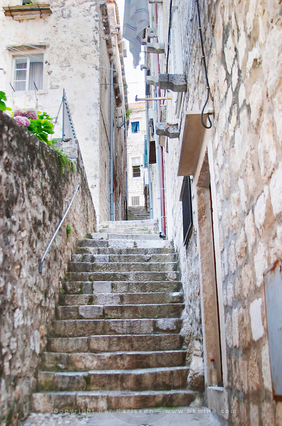 A narrow street with steep stairs Dubrovnik, old city. Dalmatian Coast, Croatia, Europe.
