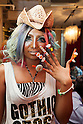 Erimokkori, a member of staff, shows off her nail art at the Ganguro Cafe &amp; Bar in the Shibuya shopping area on September 4, 2015. <br /> <br /> Ganguro is an alternative Japanese fashion trend which started in the mid-1990s where young women, rebelling against the traditional idea of Japanese beauty, wore colorful make-up and clothes and had dark-skin.<br /> <br /> 10 Ganguro fashion girls work in the new bar, which offers original Ganguro Balls (fried takoyaki style sausage balls in black squid ink batter) on its menu. Ganguro Caf&eacute; &amp; Bar also offers special services such as Ganguro make-up and the chance to take purikura (photo booth pictures) with staff and to look like a Ganguro girl walking around the Shibuya streets.<br /> <br /> The bar is popular with both Japanese and foreigners and has menus translated in English. (Photo by Rodrigo Reyes Marin/AFLO)