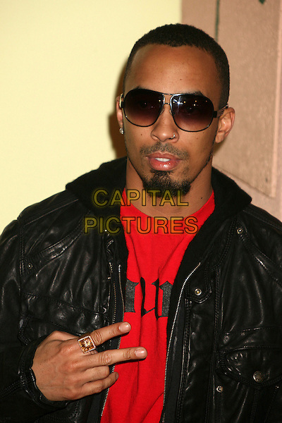 DALLAS AUSTIN.Sony / BMG 2007 GRAMMY Awards After Party at the Beverly Hills Hotel, Beverly Hills, California, USA..February 11th, 2007.headshot portrait hand gesture sunglasses shades goatee facial hair .CAP/ADM/BP.©Byron Purvis/AdMedia/Capital Pictures