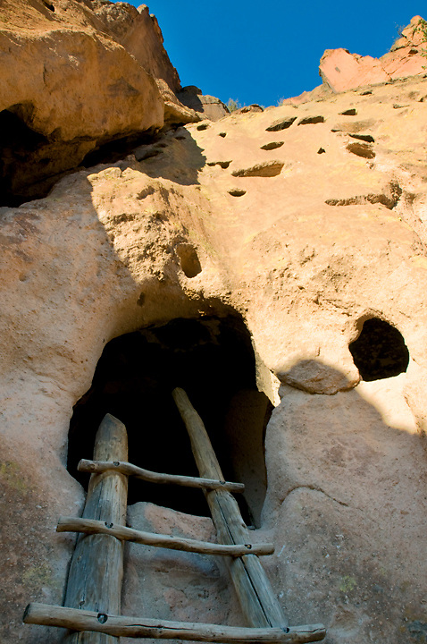 A ladder enters a cavette, where Ancestral Puebloans made their homes in Frijoles Canyon. <br /> Bandelier National Monument, NM