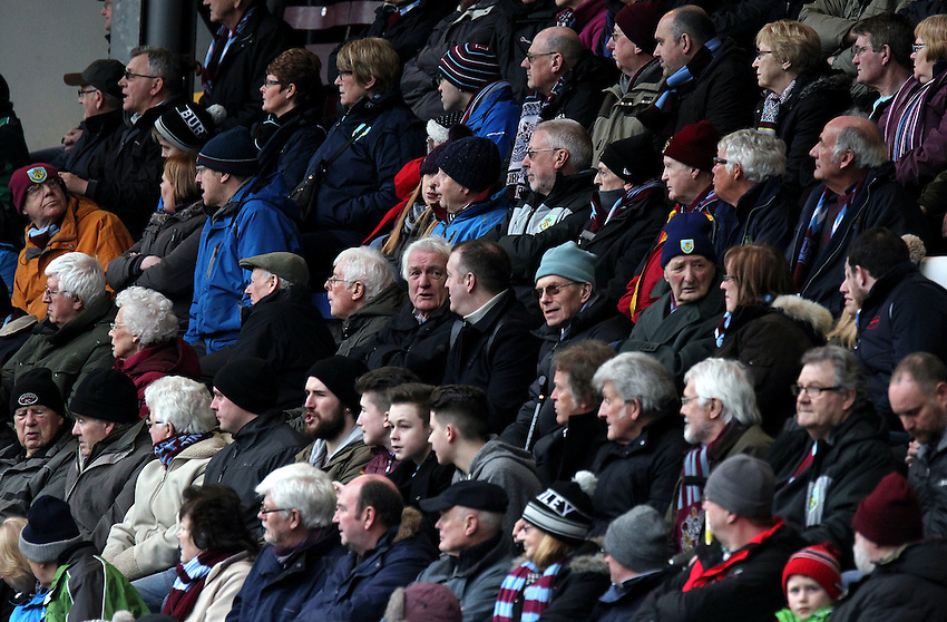 Burnley fans watch the first half action<br /> <br /> Photographer Rich Linley/CameraSport<br /> <br /> Football - Barclays Premiership - Burnley v Swansea City - Friday 27th February 2015 - Turf Moor - Burnley<br /> <br /> &copy; CameraSport - 43 Linden Ave. Countesthorpe. Leicester. England. LE8 5PG - Tel: +44 (0) 116 277 4147 - admin@camerasport.com - www.camerasport.com