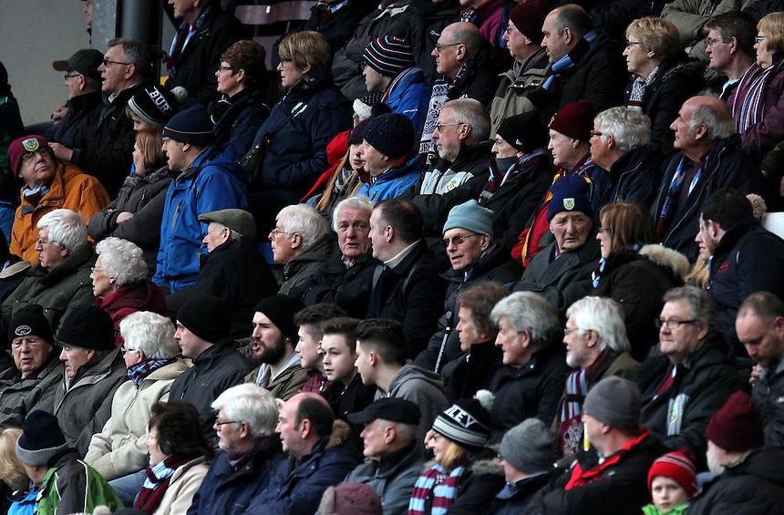 Burnley fans watch the first half action<br /> <br /> Photographer Rich Linley/CameraSport<br /> <br /> Football - Barclays Premiership - Burnley v Swansea City - Friday 27th February 2015 - Turf Moor - Burnley<br /> <br /> &copy; CameraSport - 43 Linden Ave. Countesthorpe. Leicester. England. LE8 5PG - Tel: +44 (0) 116 277 4147 - admin@camerasport.com - www.camerasport.com