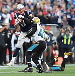 (Foxboro, MA, 01/21/18) New England Patriots tight end Rob Gronkowski (87) hauls in pass over Jacksonville Jaguars' Tashaun Gipson (39) and Jacksonville Jaguars' Barry Church during the second quarter of the AFC championship NFL football game at Gillette Stadium on Sunday, January 21, 2018. Photo by Christopher Evans