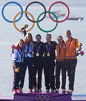 10.08.2012, Bucht von Weymouth, GBR, Olympia 2012, Segeln, Damen, 470er, Podium, im Bild Saskia Clark, Hannah Mills (GBR, Silber medaille), Jo Aleh, Olivia Powrie (NZL, Gold Medaille), Lobke Berkhout, Lisa Westerhof (NED; bronze Medaille) // silver Medal Saskia Clark, Hannah Mills (GBR), Jo Aleh, gold Medal Olivia Powrie (NZL), Lobke Berkhout, bronze Medal Lisa Westerhof (NED) during Sailing women's medal race 470er at the 2012 Summer Olympics at Bay of Weymouth, United Kingdom on 2012/08/10. EXPA Pictures © 2012, PhotoCredit: EXPA/ Johann Groder .Olimpiadi Londra 2012.London 2012 Olympic Games.foto Insidefoto - Italy ONLY